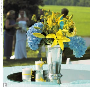 Blue wedding floral centerpieces the wedding specialiststhe weddingseknot junglespirit Images