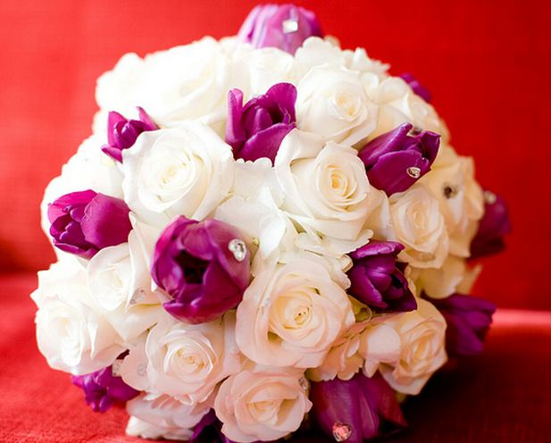 Wedding bouquet with white roses and purple tulips with rhinestones